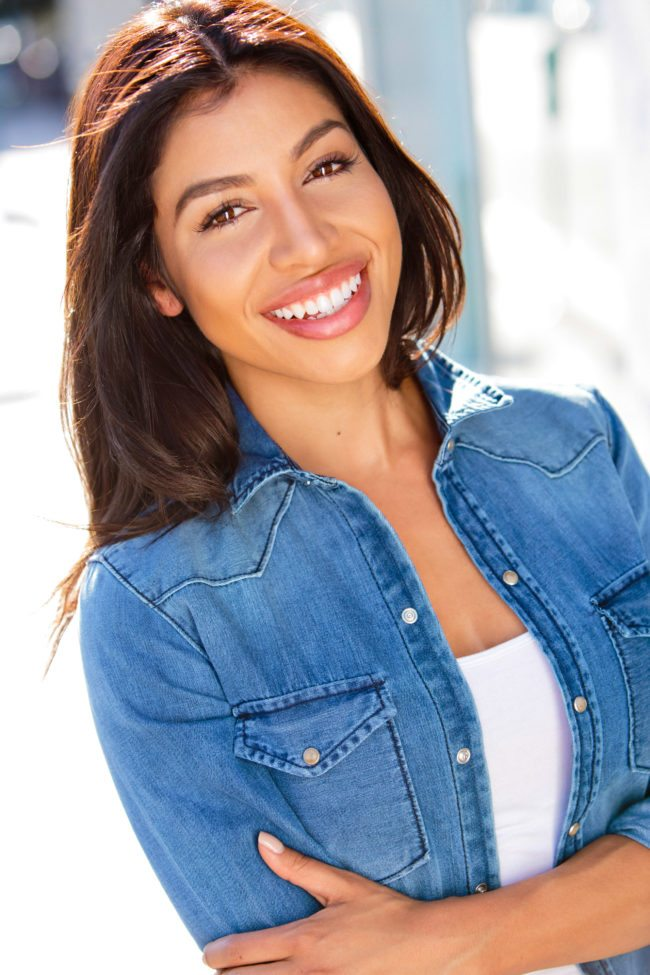 Smiling Evelyn Gonzalez photographed by Michael Roud Photography in Los Angeles