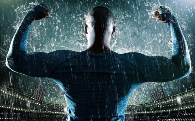 NFL Player Showing off Guns in the Rain at the Stadium