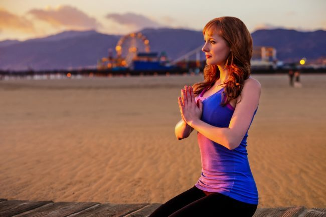 Headshot of Yoga at the Beach with Ferris Wheel in Distance