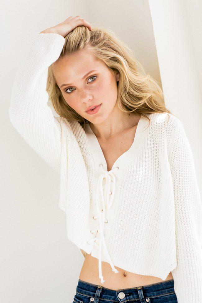 Maddie Reed in white sweater photographed by Michael Roud Photography in Los Angeles
