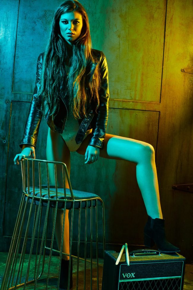 Model wearing leather jacket with moody lighting