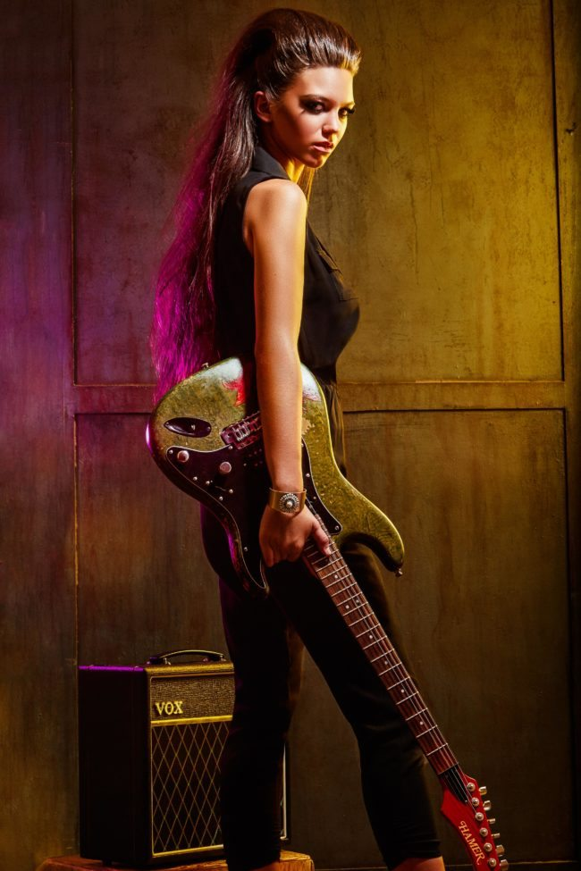 Female Bassist in Edgy Scene by Top Photographer Michael Roud