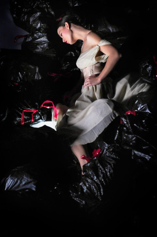 Asian model in black trash bags by Michael Roud Photography
